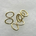 Oval jump rings, 5 x 7mm, gold coloured.