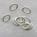 Oval jump rings, 5 x 7mm, silver coloured.
