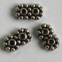 Small two hole spacer, antique silver coloured.