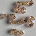 Swarovski 5301, 4mm bi-cone crystal, light peach.