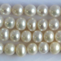 Freshwater pearl, b grade, round ovals, ivory white.