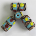 Pale blue and gold lamp-work tube bead with yellow, red and black decoration.