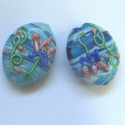 Oval lamp-work bead. Turquoise blue with decoration. Pk of 2.