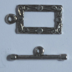 Embossed rectangular toggle clasp.