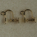 Screw on ear clips, gold coloured, sold per pair.