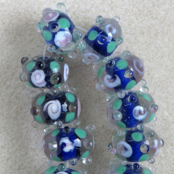SET of clear, blue lined handmade lamp-work glass beads.