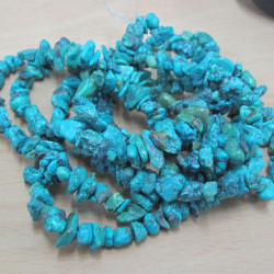 Turquoise colour chips. Strand 35 inch.