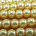 Strand of 6mm yellow glass pearls.