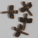Antique copper coloured dragonfly charm. Pack of 10.
