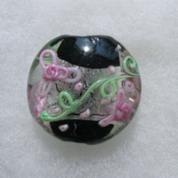 Large coin shape bead. Silver foiled and black in centre with pink and green decoration