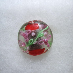 Large coin shape bead, silver-foiled, red in centre with pink and green decoration.