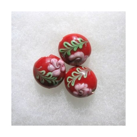 LW06 - Red lampwork coin bead with green and pink decoration.