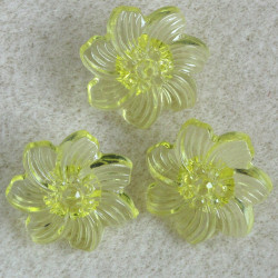Lucite flower buttons, translucent yellow. Pack of 10.