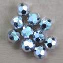Silvered, plastic beads with a hexagonal design, pack of 10.