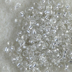 Size 11 silver lined, clear seed beads. Pack of 20g.