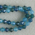 Blue and turquoise mixed shades, bi-cone beads, per strand.