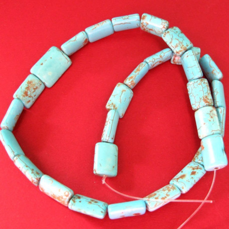 S2499 - Magnestite rectangular beads. Per strand