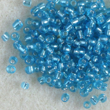 SBSL1106 - Size 11 Silver Lined, Turquoise Blue Seed Beads. Pack of 20g.