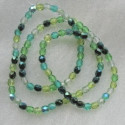 4mm firepolished green tones mix Czech glass. Pack of 100.