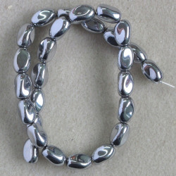 Silver coloured, oval glass beads.