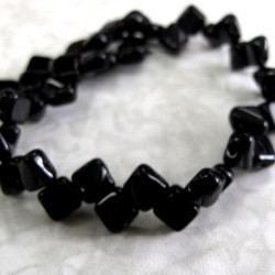SIL002 - Black silky beads. 1 strand of 2 hole beads