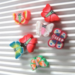 Polymer clay butterfly beads. Pack of 20.