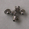 Antique silver colour decorated bicone beads. Pack of 10.