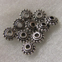 Antique silver colour disc bead. Pack of 20.
