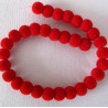 Red flock beads, per strand