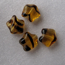Czech glass star bead, tortoise shell brown. String of 25.