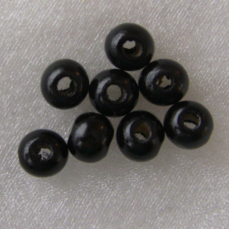 WB2120 - Black wooden beads, not perfect rounds. Pack of approx 75.