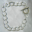 Bracelet base silver colour with toggle clasp. Size medium.