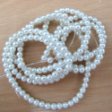 Long string of 4mm white glass pearls.