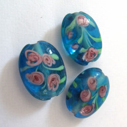 LW21 - Blue bead with pink flowers.