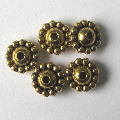 "F4300g - Antique gold colour ""Saturn"" bead. Pack of 10"