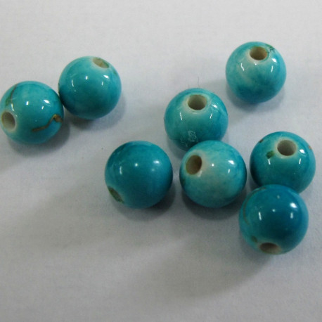 AC5134 - 6mm turquoise col with hint of gold. Pack of 100
