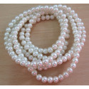 Long strand of 4mm ivory white glass pearls.