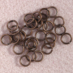 7mm jump rings, antique copper colour.