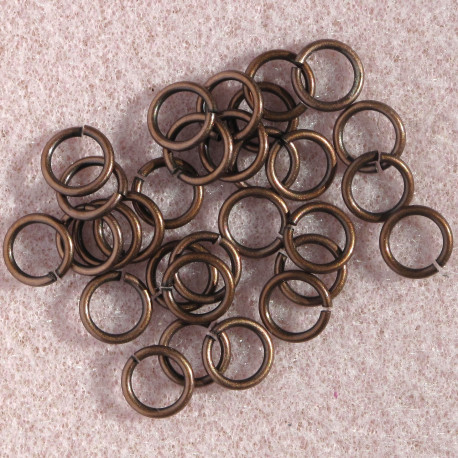 F4272C - 7mm Jump Rings, Antique Copper Colour.
