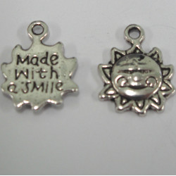 Antique silver colour sun charms. Made with a smile. Pack of 10