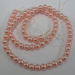 PL0604 -Soft peach 6mm glass pearls. Approx 75 per string