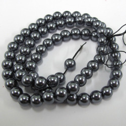 PL0605 -Gunmetal grey 6mm glass pearls. Approx 70 per string