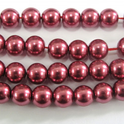 6mm raspberry coloured glass pearls, approx 70 per string.
