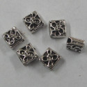 Diamond shaped silver coloured spacer bead.